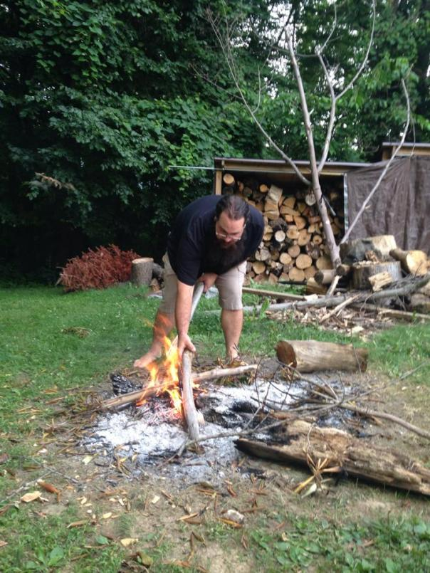 Bill doing a fire starting demonstration.